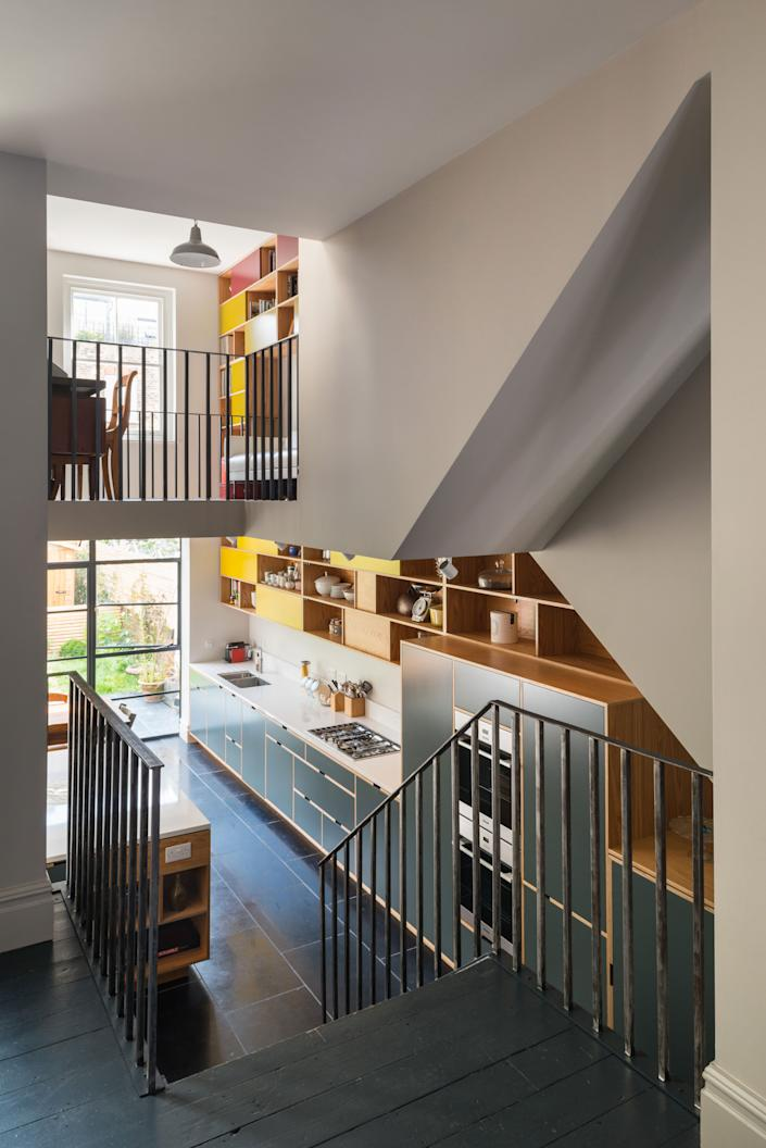 """<div class=""""caption""""> Cabinetry with sliding doors moves up through a void in the ceiling. </div> <cite class=""""credit""""><a href=""""https://www.frenchandtye.com/"""" rel=""""nofollow noopener"""" target=""""_blank"""" data-ylk=""""slk:FRENCH+TYE"""" class=""""link rapid-noclick-resp"""">FRENCH+TYE</a></cite>"""