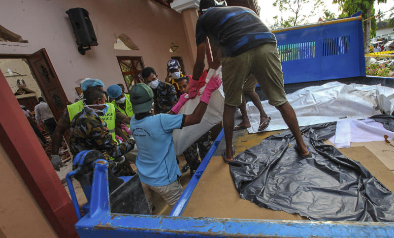 Dead bodies of blast victims are removed from St. Sebastian's Church in Negombo, north of Colombo, Sri Lanka, Sunday, April 21, 2019. More than hundred were killed and hundreds more hospitalized with injuries from eight blasts that rocked churches and hotels in and just outside of Sri Lanka's capital on Easter Sunday, officials said, the worst violence to hit the South Asian country since its civil war ended a decade ago. (AP Photo/Chamila Karunarathne)