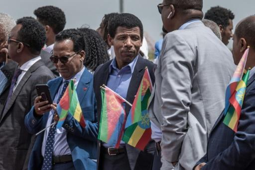 Ethiopia's retired double Olympic champion, Haile Gebrselassie, centre, was among those who welcomed the Eritrean delegation
