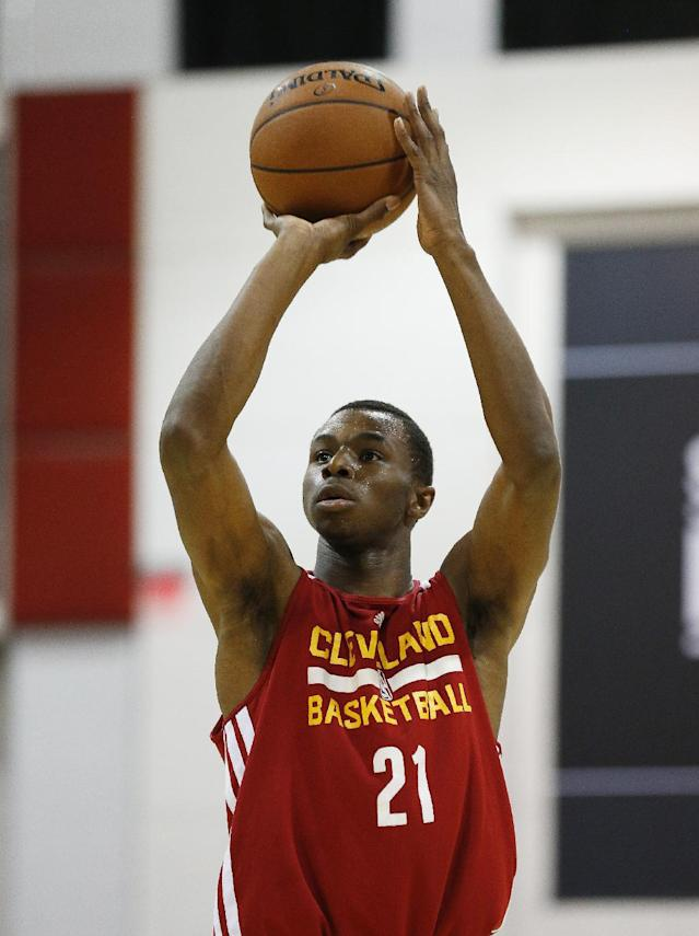Andrew Wiggins of the Cleveland Cavaliers takes a free throw against the Milwaukee Bucks in an NBA summer league basketball Friday, July 11, 2014, in Las Vegas. (AP Photo/John Locher)