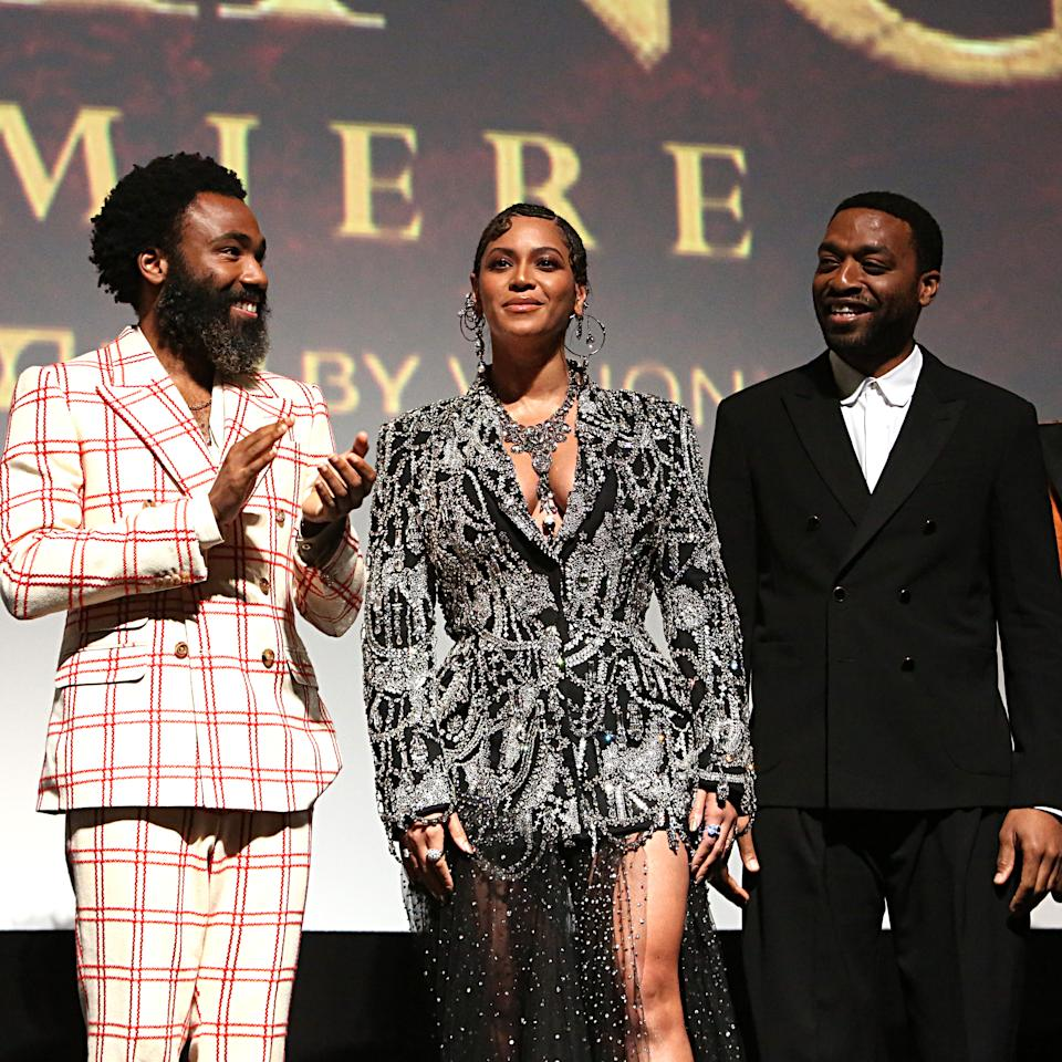 """HOLLYWOOD, CALIFORNIA - JULY 09: (EDITORS NOTE: Retransmission with alternate crop.) (L-R) Donald Glover, Beyonce Knowles-Carter, and Chiwetel Ejiofor attend the World Premiere of Disney's """"THE LION KING"""" at the Dolby Theatre on July 09, 2019 in Hollywood, California. (Photo by Jesse Grant/Getty Images for Disney)"""
