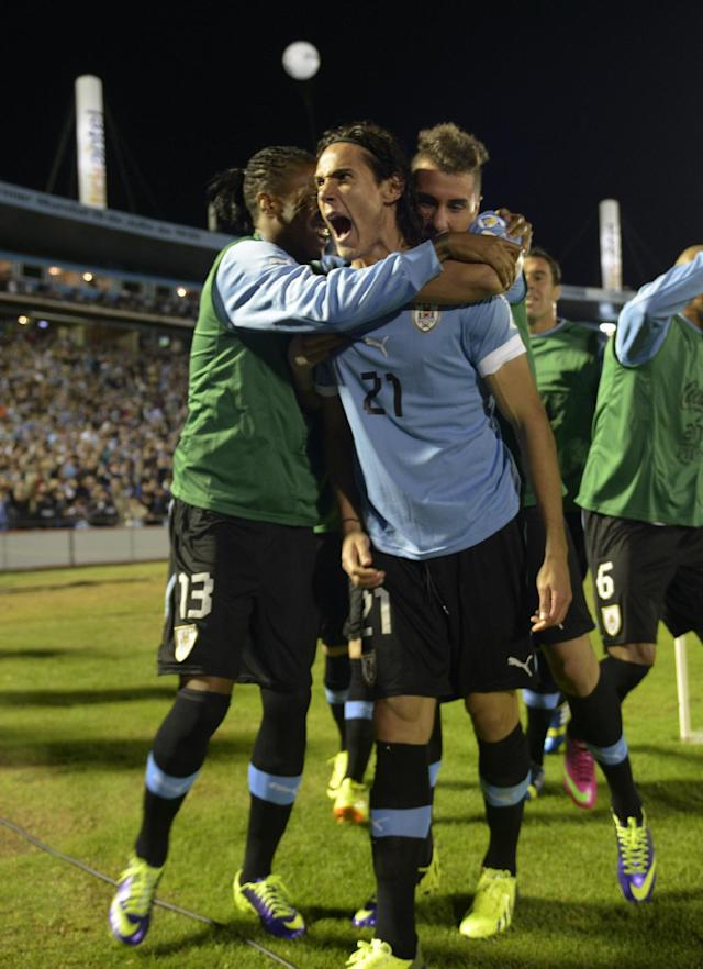 Uruguay's Edinson Cavani, center, celebrates with teammates after scoring against Argentina during a 2014 World Cup qualifying soccer game in Montevideo, Uruguay, Tuesday, Oct. 15, 2013. (AP Photo/Matilde Campodonico)
