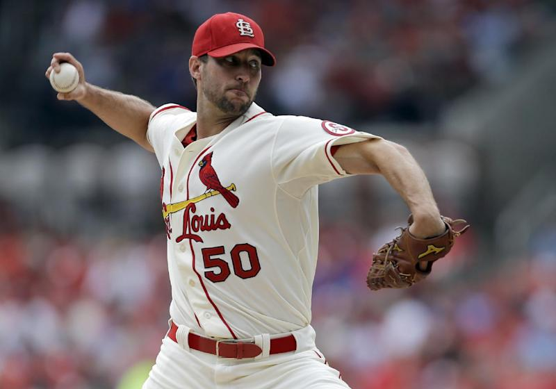 St. Louis Cardinals starting pitcher Adam Wainwright throws during the first inning of a baseball game against the Chicago Cubs, Saturday, Sept. 28, 2013, in St. Louis. (AP Photo/Jeff Roberson)