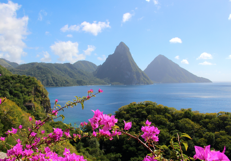 """<p>Like a scene from Jurassic Park, the emerald green mountains (or as they're known in St. Lucia, Pitons) tower over secluded, golden beaches, two prominent peaks dropped in the middle of the Caribbean Sea, offering unspoiled viewpoints over azure seas and vibrant jungles.</p><p>Far and away the most mesmerizing view on the island is from the <a href=""""http://www.jademountain.com/"""" rel=""""nofollow noopener"""" target=""""_blank"""" data-ylk=""""slk:Jade Mountain"""" class=""""link rapid-noclick-resp"""">Jade Mountain</a> resort, as it not only offers guests astonishing unobstructed views of St. Lucia's trademark mountains, but also 600 acres of exclusivity and privacy. The resort resembles a floating sanctuary, with buildings connected by bridges that seem to suspend effortlessly over abundant flora and fauna. If you're looking for a view that's nestled in a private cove, spend your nights at <a href=""""https://www.viceroyhotelsandresorts.com/en/sugarbeach/reservations/special_offers/prepay?cmpid=ppc-google-summer18-vsb&s_kwcid=AL!4331!3!273178468276!e!!g!!sugar%20beach%20resort&ef_id=WLNoXQAABUC31RzN:20180716162151:s"""" rel=""""nofollow noopener"""" target=""""_blank"""" data-ylk=""""slk:Sugar Beach, a Viceroy Resort"""" class=""""link rapid-noclick-resp"""">Sugar Beach, a Viceroy Resort</a>, which has a more secluded vibe, and looks out on the Pitons and the island's epic sunsets.</p>"""