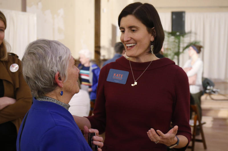 FILE—In this Feb. 18, 2020, file photo,Kate Schroder, Democratic candidate for Ohio's first congressional district, right, greets a woman following a question and answer session held by the Bold New Democracy Work Group, in Cincinnati. In Ohio, candidates such as Schroder and Nikki Foster nearly emptied their campaign coffers in the closing days before March 17, and now are focusing on social media and phone banks to keep up their campaigns while awaiting clarity on when the primary will end amid the coronavirus stay-home orders. (AP Photo/Gary Landers, File)