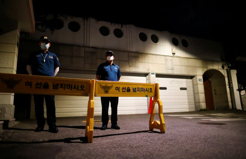Rescue workers conduct a search operation for Seoul Mayor Park Won-soon in Seoul