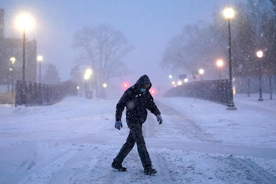 <p>A man keeps his head down while crossing the Villanova University campus in Pennsylvania on Wednesday.</p>