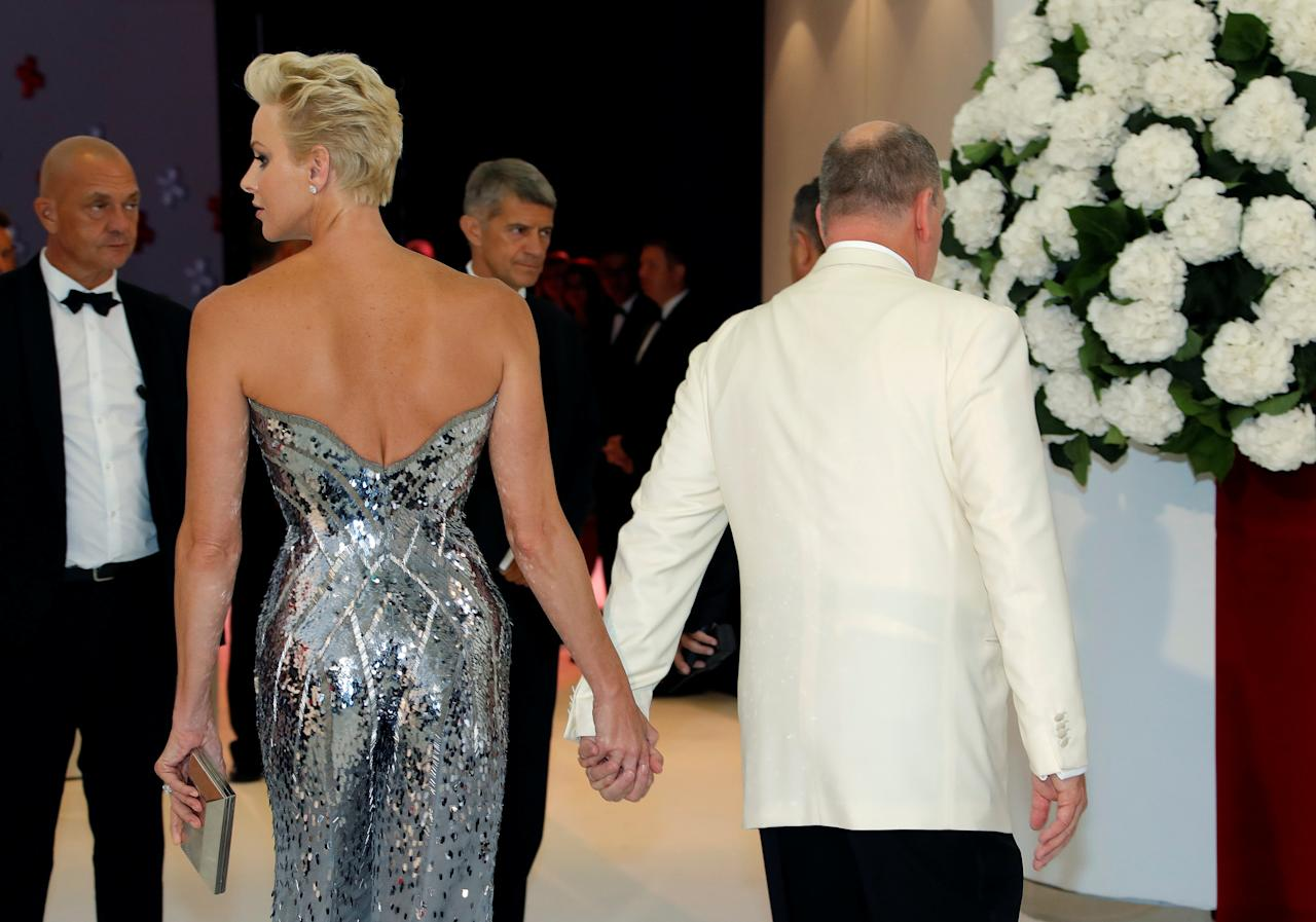 Prince Albert II of Monaco and his wife Princess Charlene arrive for the annual Red Cross Gala in Monaco, July 28, 2017.       REUTERS/Eric Gaillard