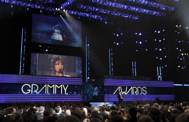 LL Cool J is seen onstage at the 54th annual Grammy Awards on Sunday, Feb. 12, 2012 in Los Angeles. (AP Photo/Matt Sayles)