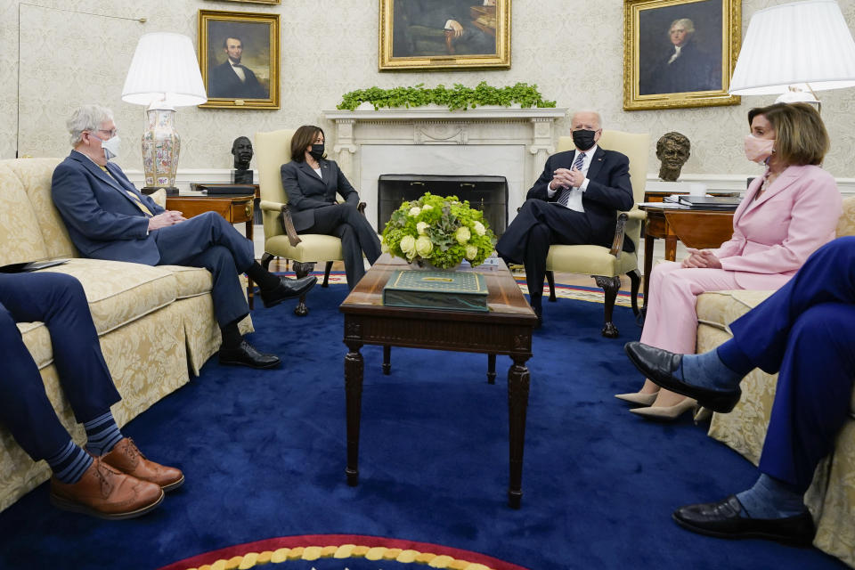 FILE - In this May 12, 2021, file photo President Joe Biden speaks during a meeting with congressional leaders in the Oval Office of the White House in Washington. From left, House Minority Leader Kevin McCarthy of Calif., Senate Minority Leader Mitch McConnell of Ky., Vice President Kamala, Biden, House Speaker Nancy Pelosi of Calif., and Senate Majority Leader Chuck Schumer of N.Y. (AP Photo/Evan Vucci, File)