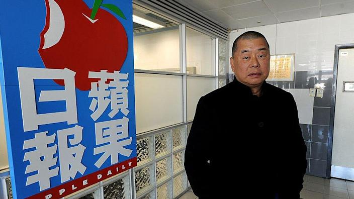 Taken on February 7, 2011, this photo shows Hong Kong media mogul Jimmy Lai outside his headquarters in Hong Kong. Rye,