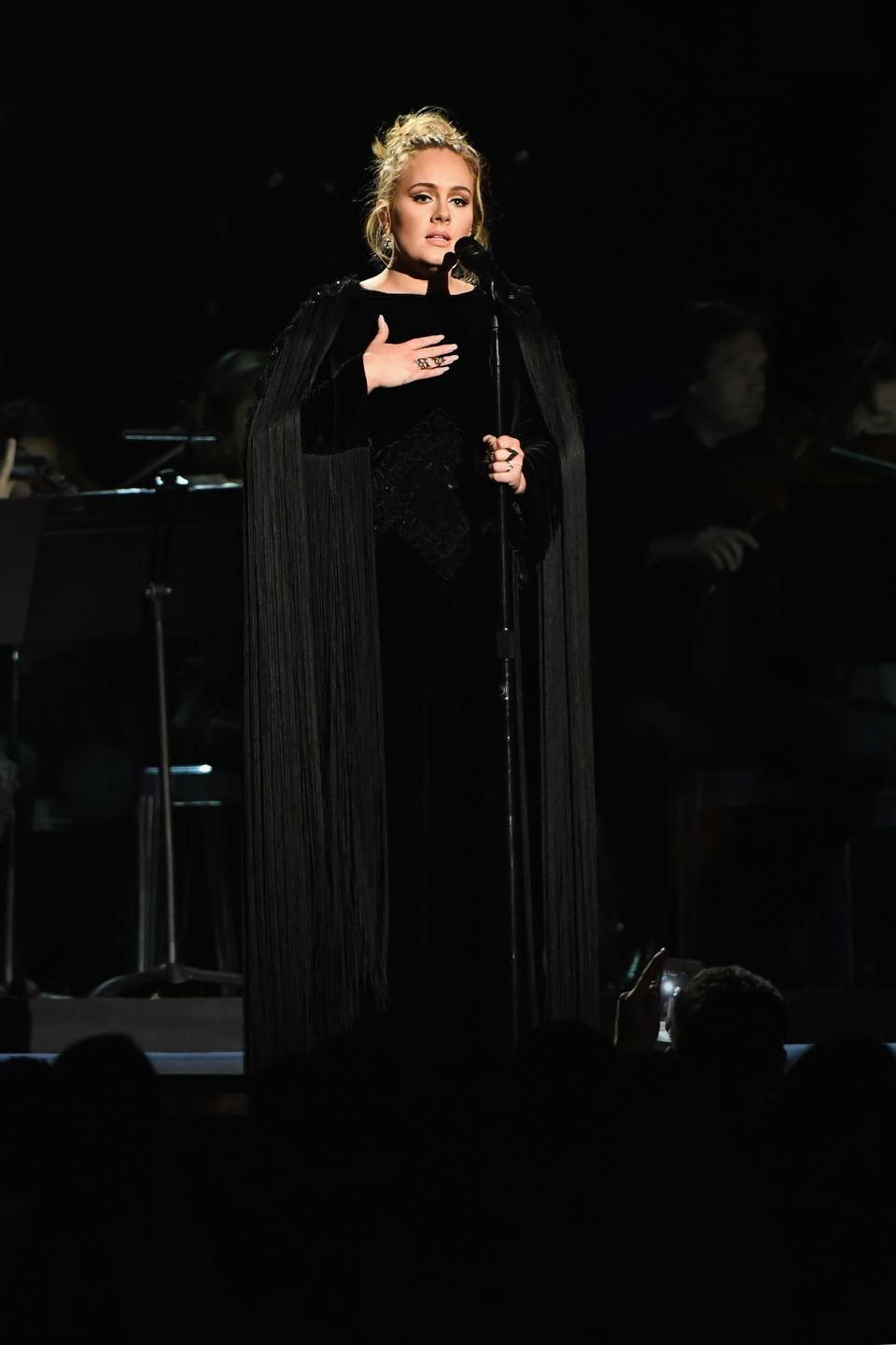 <p>She rounded off the night by performing in a black Givenchy gown with its dramatic fringed cape and sleeves. </p>