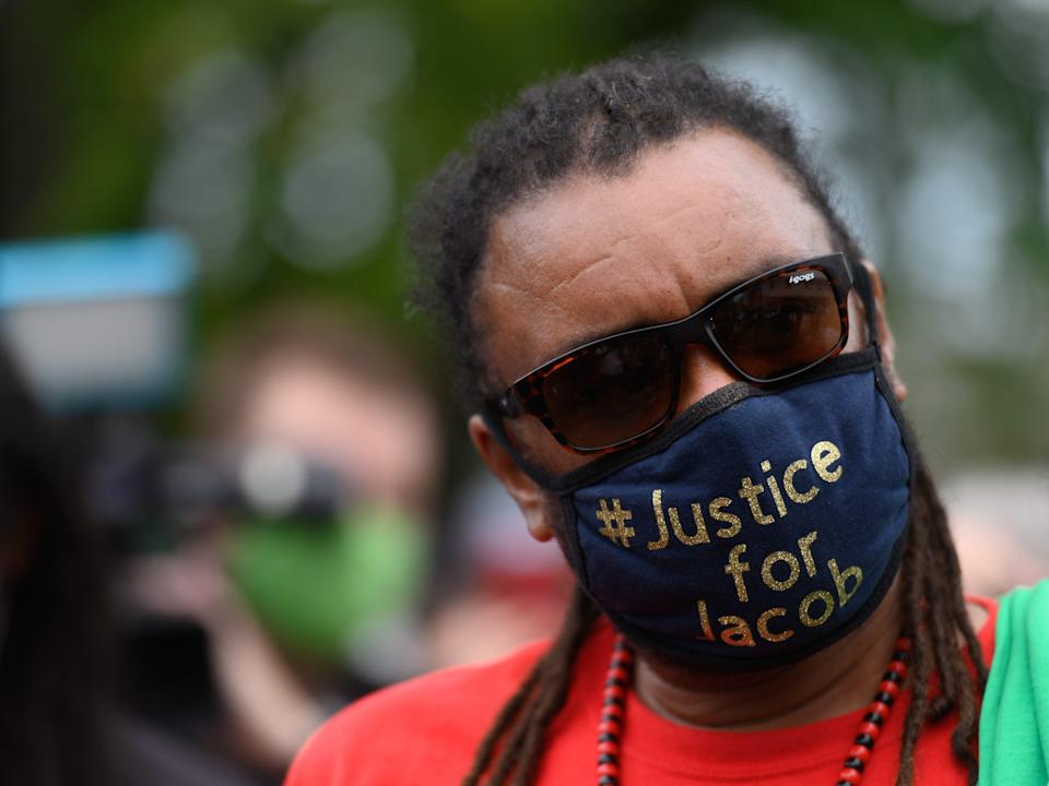justin blake wears a mask that says justice for jacob