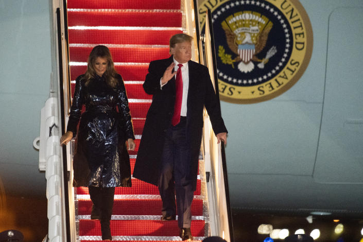 President Donald Trump and first lady Melania Trump exit Air Force One early Tuesday, Jan. 14, 2020, at Andrews Air Force Base, Md., after attending the College Football National Championship game in New Orleans. (AP Photo/Kevin Wolf)