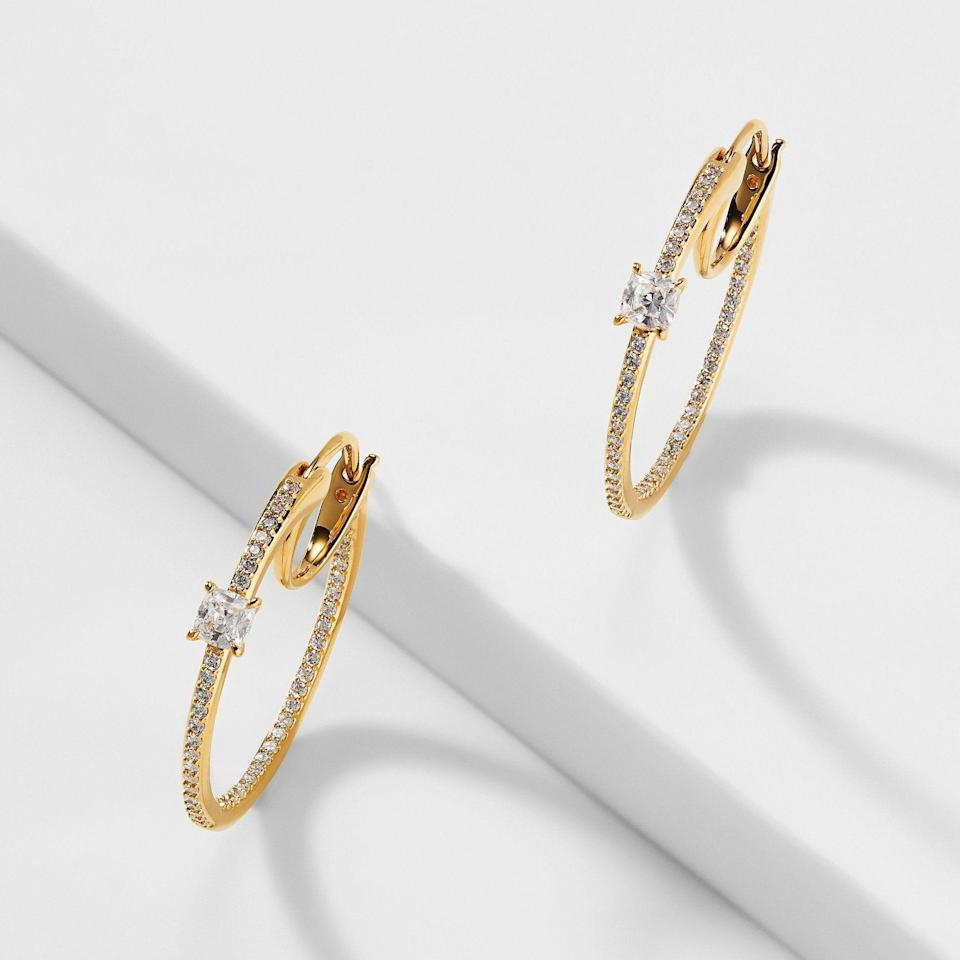 """<p><strong>NADRI</strong></p><p>nadri.com</p><p><strong>$65.00</strong></p><p><a href=""""https://nadri.com/collections/earrings/products/emilia-cz-hoop-earrings"""" rel=""""nofollow noopener"""" target=""""_blank"""" data-ylk=""""slk:Shop Now"""" class=""""link rapid-noclick-resp"""">Shop Now</a></p><p>Just because you have sensitive ears doesn't mean you can't rock a statement earring—and these are begging to be worn on your next date night.</p>"""