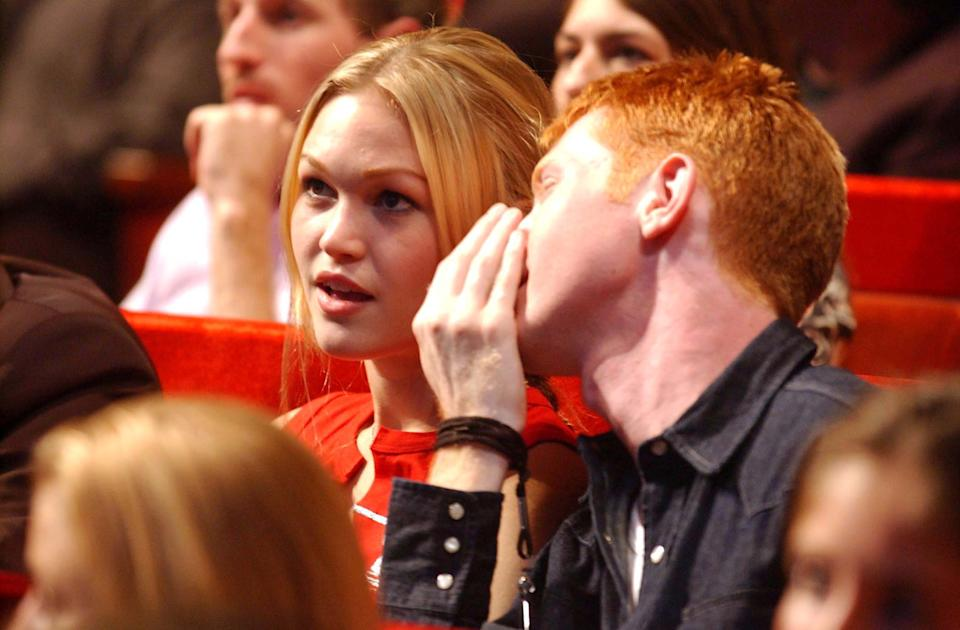 Julia Stiles and guest during 2001 MTV Video Music Awards - Show at Metropolitan Opera House in New York City, New York, United States. (Photo by Jeff Kravitz/FilmMagic, Inc)