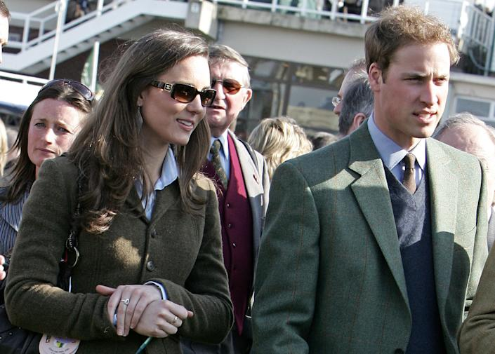 Britain's Prince William (R) stands beside girlfriend Kate Middleton (L) in the paddock enclosure on the first day of the Cheltenham Race Festival at Cheltenham Race course, in Gloucestershire 13 March 2007. (Photo credit should read CARL DE SOUZA/AFP via Getty Images)