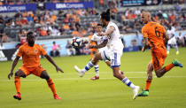 Montreal Impact's Maximiliano Urruti, center, passes the ball between Houston Dynamo's Maynor Figueroa (15) and Aljaz Struna (6) during the second half of an MLS soccer match Saturday, March 9, 2019, in Houston. (AP Photo/David J. Phillip)