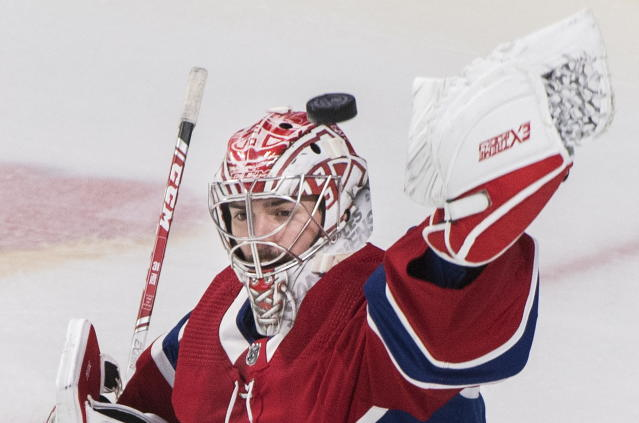 Montreal Canadiens goaltender Carey Price makes a save during first-period NHL hockey game action against the New Jersey Devils in Montreal, Thursday, Nov. 28, 2019. (Graham Hughes/The Canadian Press via AP)