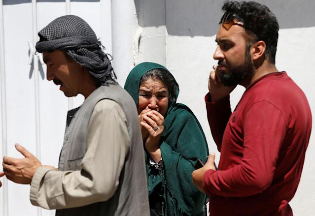 <p>Relatives of Afghan victims mourn outside a hospital after a blast in Kabul, Afghanistan May 31, 2017. (Omar Sobhani/Reuters) </p>