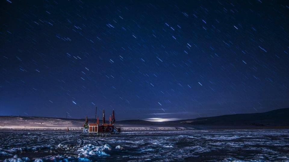 The night sky over the Lake Cildir, where parts of its surface are frozen (Kars, Turkey).