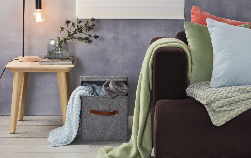 Pictured: Coles Your Home lamp, cushions and throw rugs. Image: Coles