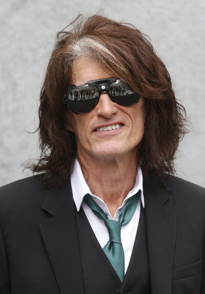 US guitarist Joe Perry attends the Emporio Armani men's Spring-Summer 2015 show, part of the Milan Fashion Week, unveiled in Milan, Italy, Monday, June 23, 2014. Perry is participating along with Dr. Anthony Fauci, soprano Renee Fleming, the CEO's of Moderna and Pfizer among others in a unique three-day Vatican conference starting Thursday, May 6, 2021, on COVID-19, other global health threats and how science, solidarity and spirituality can address them. (AP Photo/Luca Bruno)