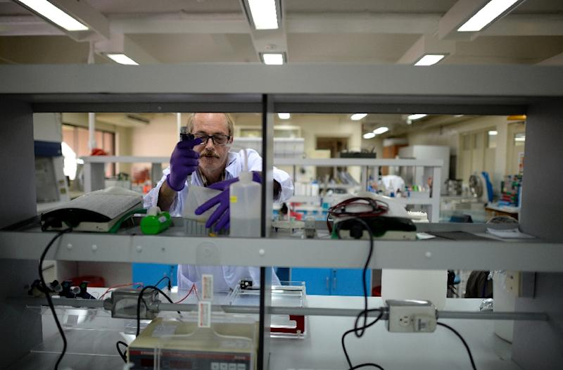 Kenneth McNally, a US biochemist at the Philippines-based International Rice Research Institute (IRRI), checks laboratory equipment at the institute in Laguna (AFP Photo/Noel Celis)