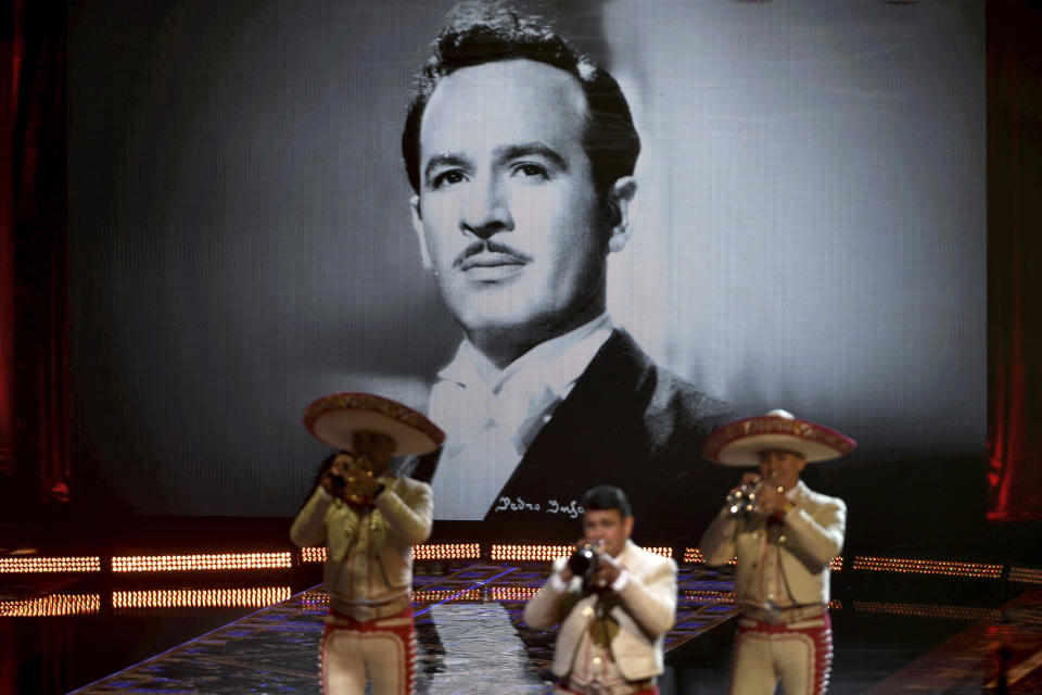 Mariachi Sol de Mexico de Jose Hernandez performs with Mexican-American singer and songwriter Lupita Infante for the 21st Latin Grammy Awards, airing on Thursday, Nov. 19, 2020, at American Airlines Arena in Miami. Their performance celebrates Infante's grandfather, Pedro Infante seen in the background screen.(AP Photo/Taimy Alvarez)