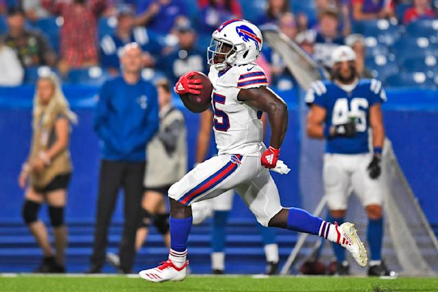 """Buffalo Bills' Christian Wade runs the ball for a touchdown during the second half of an NFL preseason football game against the Indianapolis Colts, Thursday, Aug. 8, 2019, in Orchard Park, N.Y. Wade gave up a promising career representing England in rugby to give American football a try. On his first play from scrimmage in a competitive setting, the 28-year-old from Slough _ best known for home of the BBC's version of """"The Office"""" sitcom _ scored a touchdown on a 65-yard run to help the Buffalo Bills secure a 24-16 preseason-opening win over Indianapolis. (AP Photo/Adrian Kraus)"""