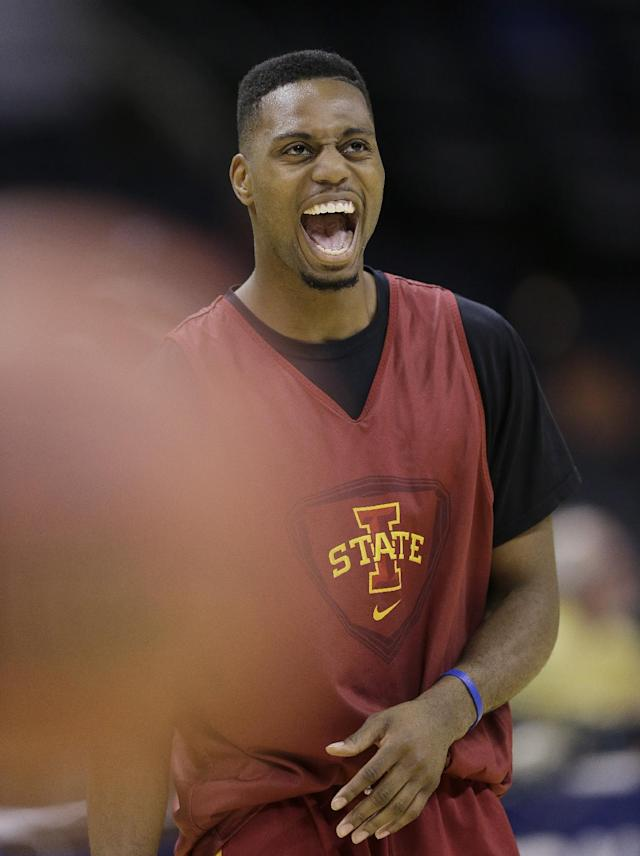 Iowa State's Melvin Ejim jokes with teammates during the team's practice for the NCAA college basketball tournament, Thursday, March 20, 2014, in San Antonio. Iowa State will face North Carolina Central on Friday. (AP Photo/Eric Gay)