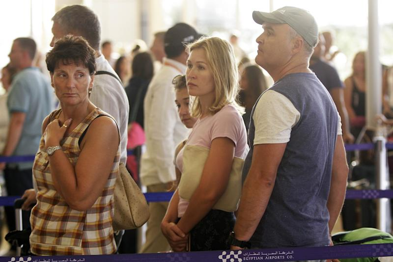 FILE - In this file photo taken on Nov. 9, 2015, Russian passengers prepare to depart from Sharm el-Sheikh Airport in south Sinai, Egypt. Russia's transportation minister said Friday, Dec. 15, 2017 flights between Moscow and the Egyptian capital of Cairo are to resume in February after a two-year hiatus. Moscow suspended flights to Egypt after an Islamic State bomb brought down a Russian airliner over Sinai in October 2015, killing all 224 people on board. (AP Photo/Ahmed Abd El-Latif, File)