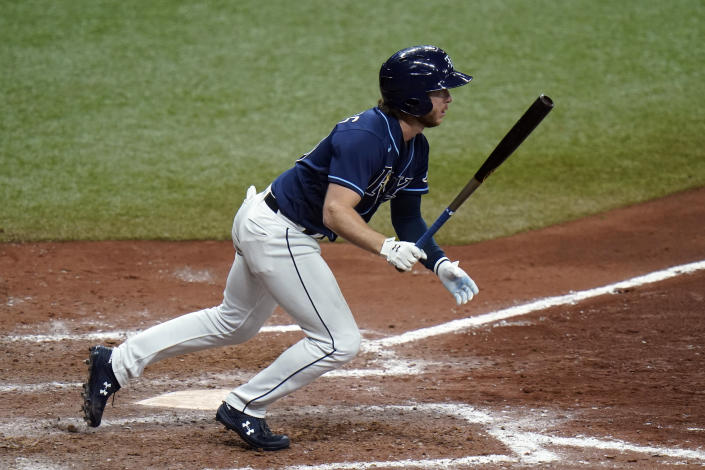 Tampa Bay Rays' Brett Phillips watches his walk-off RBI single off New York Mets relief pitcher Aaron Loup during the ninth inning of a baseball game Friday, May 14, 2021, in St. Petersburg, Fla. (AP Photo/Chris O'Meara)