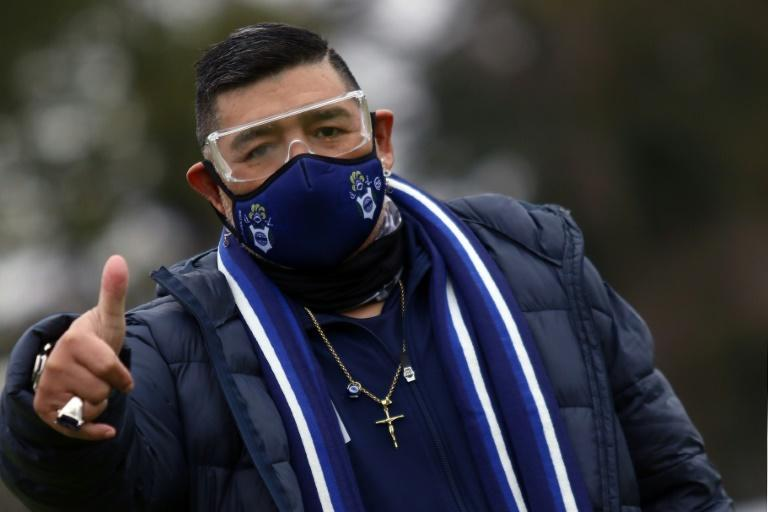 Diego Maradona (pictured September 2020) was hospitalized in Argentina, but his doctor ruled out any link to the coronavirus