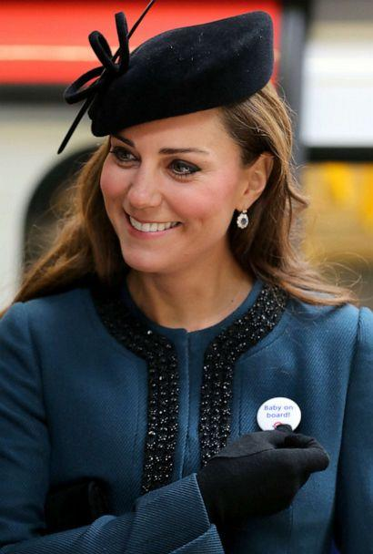 PHOTO: Catherine, Duchess of Cambridge, wears a Transport For London (TFL) badge that reads 'baby on board,' given to her during a visit to Baker Street tube station with Queen Elizabeth II and Prince Philip, Duke of Edinburgh, in London, March 20, 2013. (Chris Radburn/AFP/Getty Images, FILE)