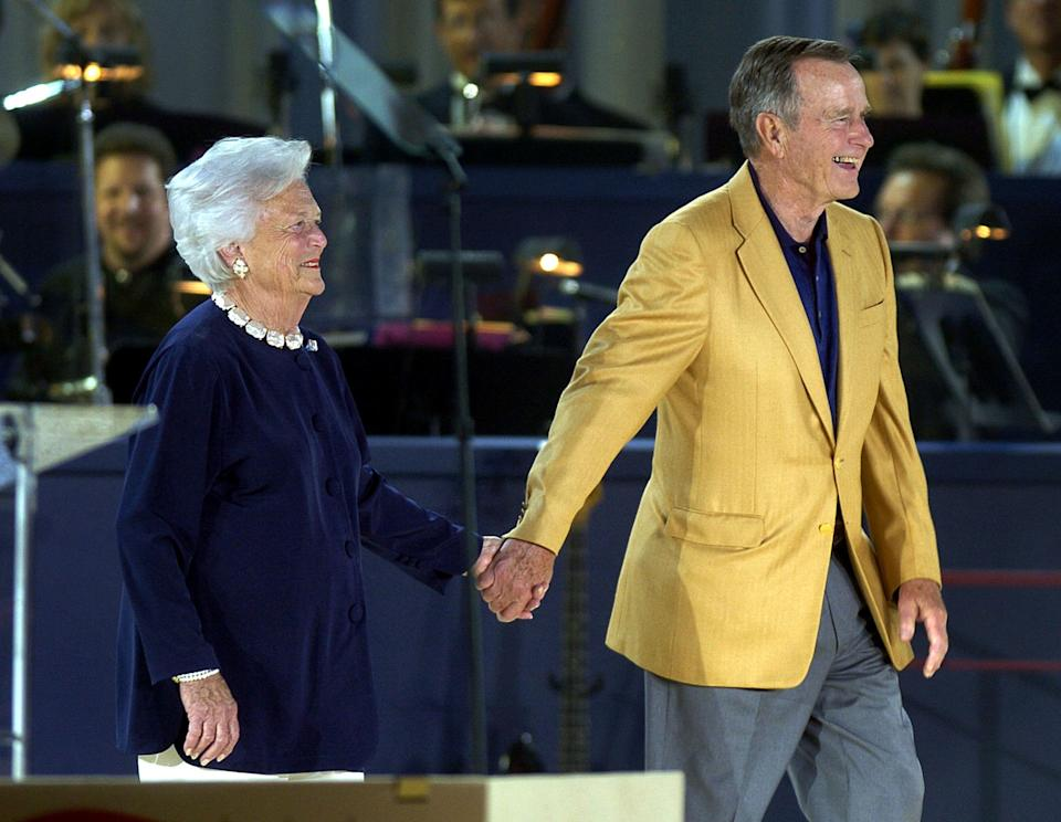 Former President George H.W. Bush and Barbara Bush smile as they are introduced at his80th birthday celebration at Minute Maid Stadium on June 12, 2004, in Houston, Texas.