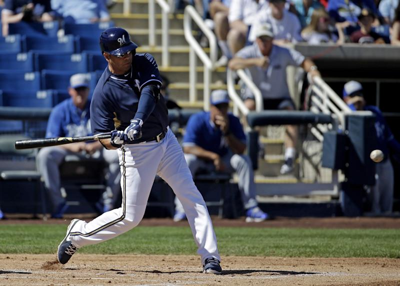 Milwaukee Brewers' Aramis Ramirez hits a three-run scoring double during the first inning of an exhibition spring training baseball game against the Kansas City Royals Saturday, March 8, 2014, in Phoenix. (AP Photo/Morry Gash)