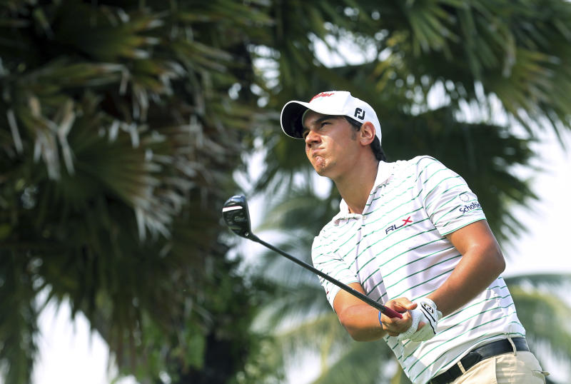 Mateo Manassero of Italy tees off on the fifteenth hole during the third round of the Singapore Open golf tournament at the Serapong Course at Sentosa Golf Club in Singapore on Sunday, Nov. 11, 2012. (AP Photo/Wong Maye-E)