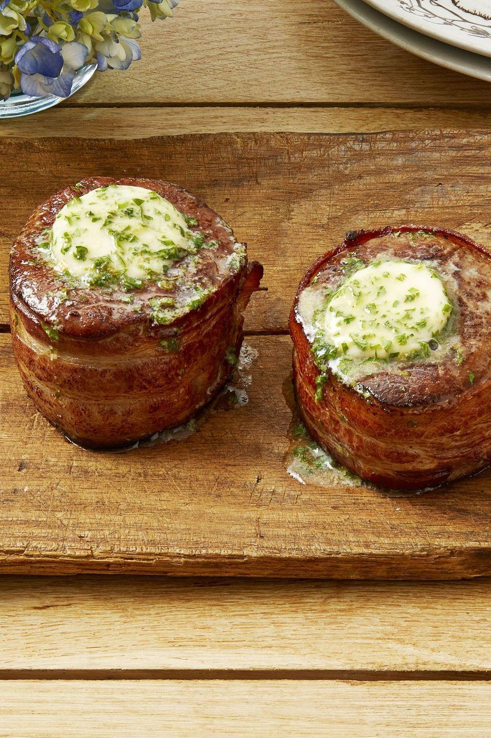 "<p>When it comes to honoring mom, steak is a must. These filets are bacon-wrapped, so they're even more delicious than your standard cuts.</p><p><strong><a href=""https://www.thepioneerwoman.com/food-cooking/recipes/a34226596/bacon-wrapped-filets-with-cowboy-butter/"" rel=""nofollow noopener"" target=""_blank"" data-ylk=""slk:Get the recipe"" class=""link rapid-noclick-resp"">Get the recipe</a>.</strong></p><p><strong><a class=""link rapid-noclick-resp"" href=""https://go.redirectingat.com?id=74968X1596630&url=https%3A%2F%2Fwww.walmart.com%2Fsearch%2F%3Fquery%3Dcookware&sref=https%3A%2F%2Fwww.thepioneerwoman.com%2Ffood-cooking%2Fmeals-menus%2Fg35589850%2Fmothers-day-dinner-ideas%2F"" rel=""nofollow noopener"" target=""_blank"" data-ylk=""slk:SHOP COOKWARE"">SHOP COOKWARE</a></strong></p>"