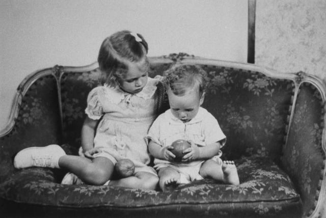 <p>Future Sen. John McCain as toddler, sits on sofa with sister Sandy in a reproduction of a family photo, circa 1938. (Photo: Terry Ashe/The LIFE Images Collection/Getty Images) </p>