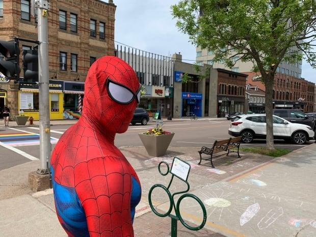 Bradford Gillis says busking as Spiderman has been his sole source of income since 2013. (Shane Ross/CBC - image credit)