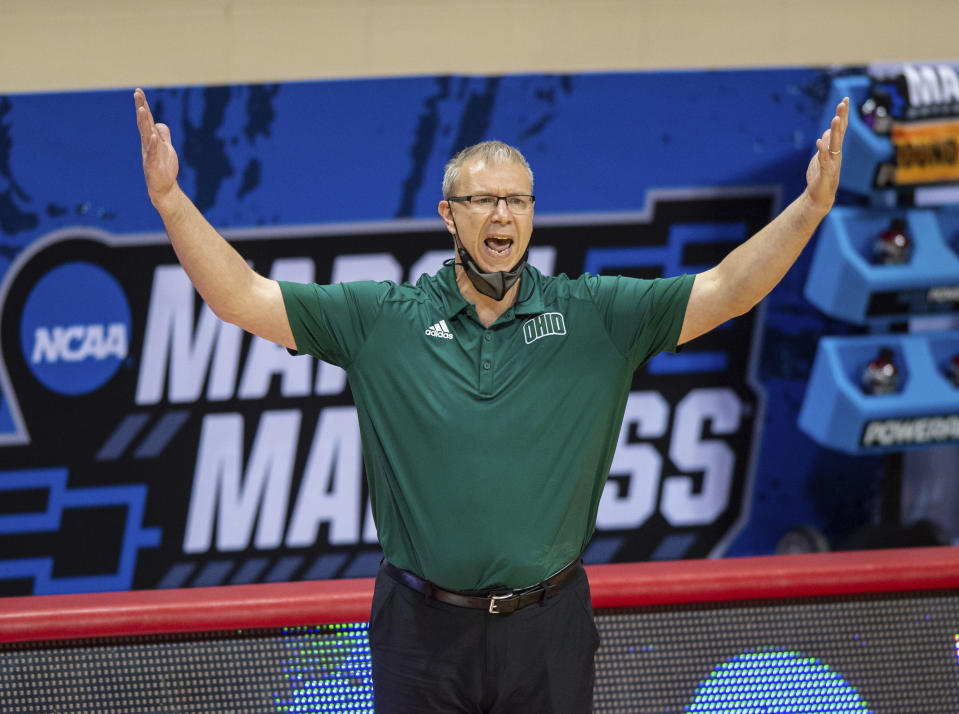 Ohio head coach Jeff Boals reacts to the action on the court during the first half of a first-round game against Virginia in the NCAA men's college basketball tournament, Saturday, March 20, 2021, at Assembly Hall in Bloomington, Ind. (AP Photo/Doug McSchooler)