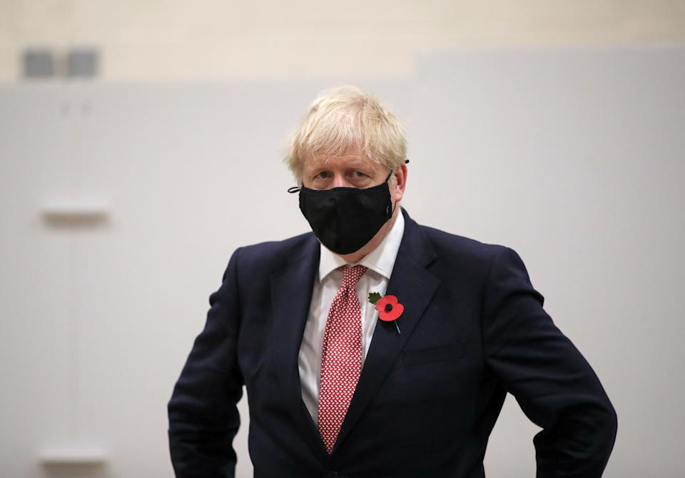 LEICESTER, ENGLAND - NOVEMBER 06: British Prime Minister Boris Johnson looks on at a testing centre in De Montfort University, amid the outbreak of the coronavirus disease (COVID-19) on November 6, 2020 in Leicester, United Kingdom. (Photo by Molly Darlington - WPA Pool/Getty Images)