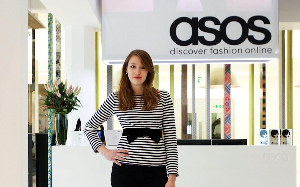 Fashion writer Ellie Pithers is seen standing in the lobby of online clothing company Asos during her day of work experience at the company - Clara Molden