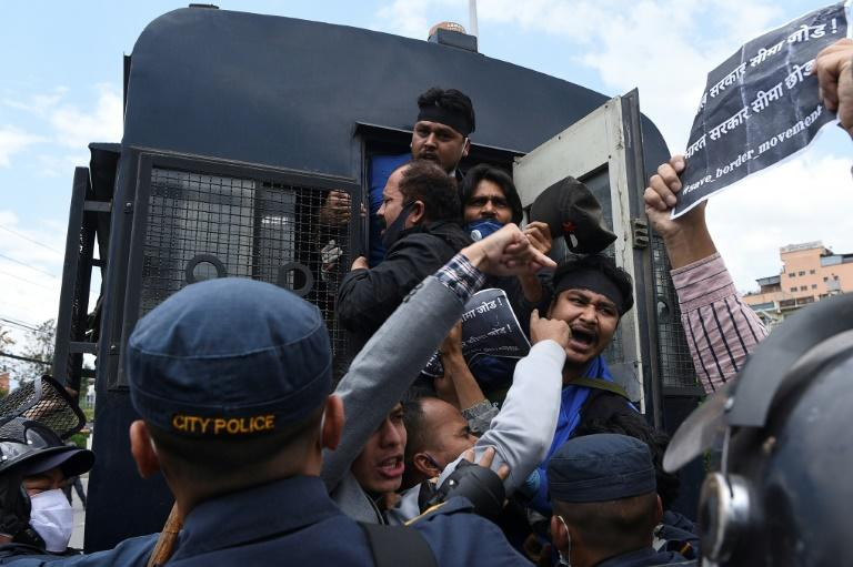 Police detain demonstrators during a protest near the Indian embassy in Kathmandu