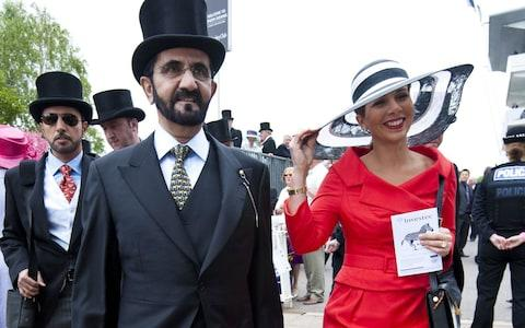 Princess Haya bint Al-Hussein (R) and her husband Sheikh Mohammed bin Rashid al-Maktoum (L) arrive for the Epsom Derby - Credit: Rex