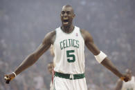 FILE - In this May 6, 2008, file photo, Boston Celtics' Kevin Garnett gestures to the crowd just before tipoff of Game 1 of an NBA Eastern Conference semifinal basketball series against the Cleveland Cavaliers in Boston. Joining Kobe Bryant as first-time finalists for the Basketball Hall of Fame are: 15-time All-Star Tim Duncan, fellow 15-time All-Star Garnett and 10-time WNBA All-Star and four-time Olympic gold medalist Tamika Catchings. (AP Photo/Winslow Townson, File)