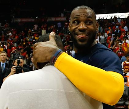 LeBron James had plenty of reason to smile after a dominant Game 2. (Mike Zarrilli/Getty Images)