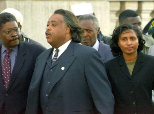 Rev. Al Sharpton (C) leaving a Bronx courthouse in March1999 with the mother of Amadou Diallo, a Guinean immigrant who was shot to death by four New York police officers; they were later acquitted of second degree murder