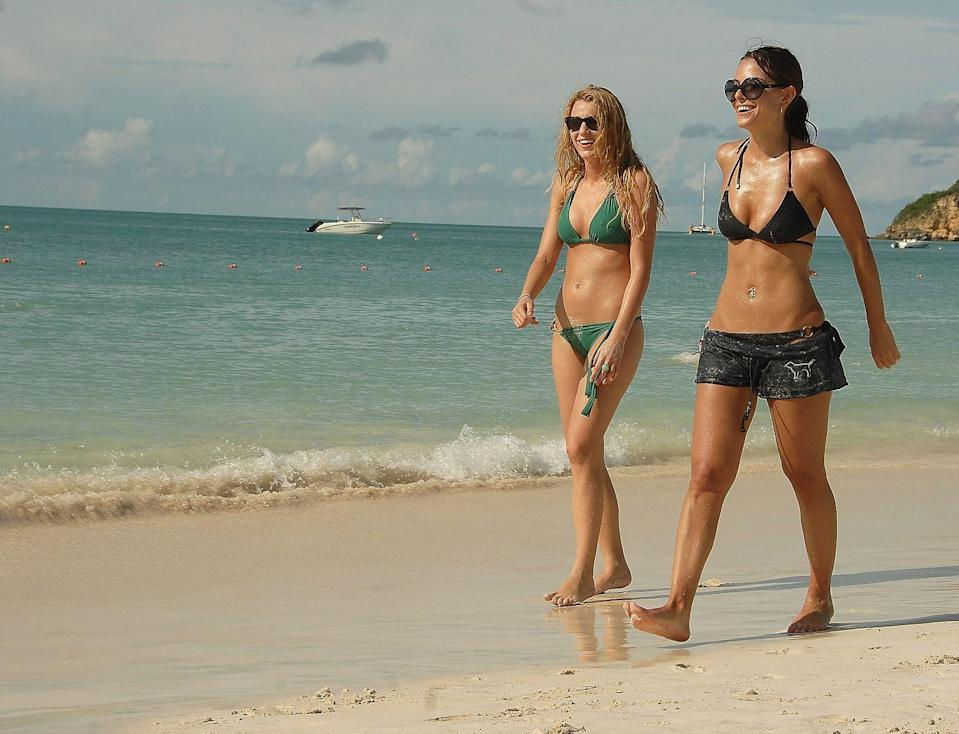 <p>Blake Lively and Maria Menounos walk along the beach in Antigua and Barbuda.</p><p>Other celebrity visitors this year: Stephen Colletti, Sean Paul, Kimora Lee Simmons, Prince Harry, Shaggy.</p>